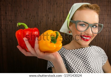 Funny woman cook holading sweet pepper, close up-FOCUS ON PEPPER