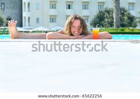 funny woman is showing her leg from the pool