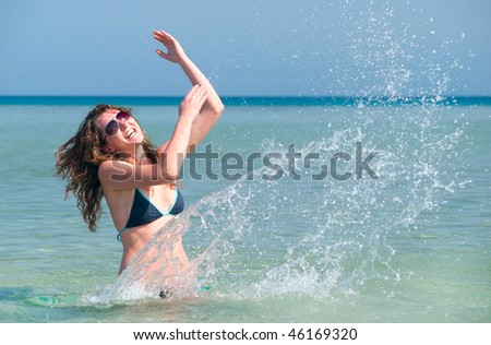funny woman splasing in the sea