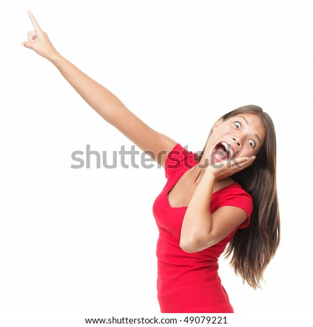 Funny woman surprised screaming and pointing at copy space. Beautiful mixed race caucasian / chinese young woman model. Isolated on white background.