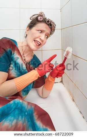 funny woman talking to brush in dirty shower