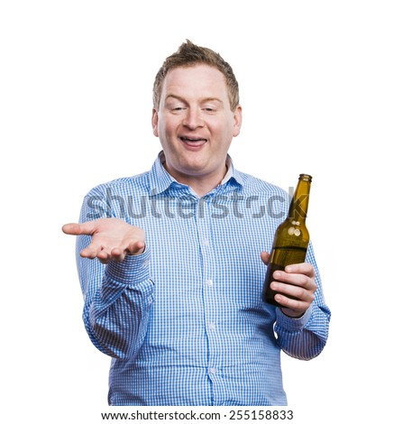 Funny young drunk man holding a beer bottle. Studio shot on white background. #255158833