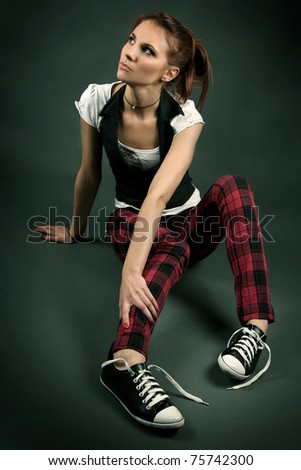 funny young girl on dark background