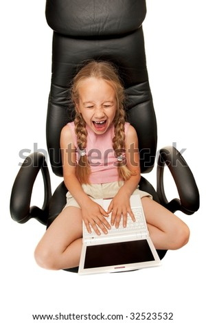 Funny young girl with laptop sitting on a chair