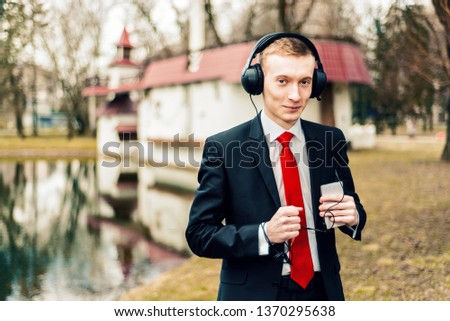 Funny Guy With Headphones Listening To Music Images And