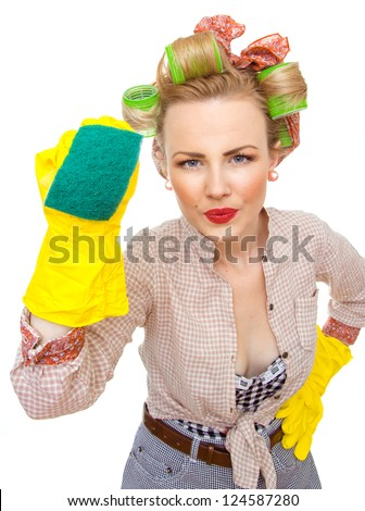 Funny young housewife with gloves holding scrubberr, isolated on white. Pin-up girl
