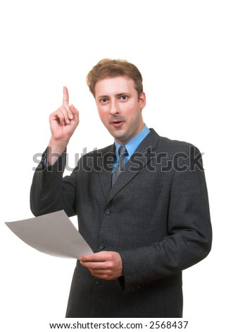 Funny young man in business suit with papers in his hand pointing his finger up as if he had an idea isolated on white