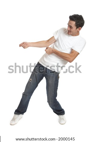 Funny young man over white background / pulling something
