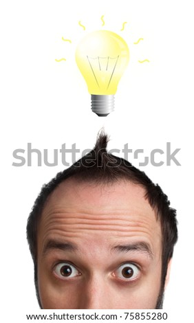 Funny young man with light  bulb over his head, isolated on white background