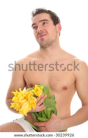 funny young man with yellow tulips