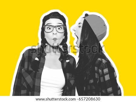 Shutterstock Funny young woman crazy shouting scream to another one. Colorful comic funny emotional hipster summer style twins teenager girls screaming, make faces and have fun. Isolated on a grey background