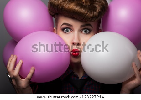 Funny Young Woman with Colorful Air Balloons Enjoying - Grimace