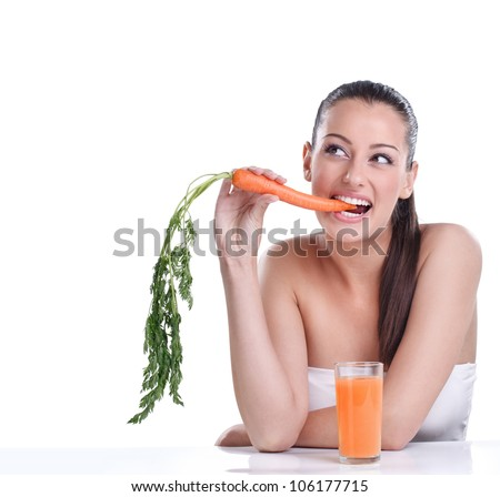 Funny young woman with the carrots juice