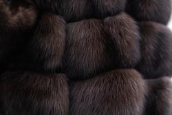 Fur texture close up. Woman in fur coat. Grey background. texture. Mink fur. mink coat. photo studio. Elegant outfit. Fashionable girl. Female fashion concept. City lifestyle. fur coat. no face