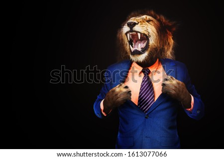 Furious angry businessman with face of lion roar Foto stock ©