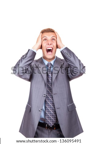 Furious angry mad business man screaming looking up hold hand on head, young frustrated and stressed businessman isolated over white background, concept of executive yelling, problem crisis