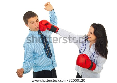Furious business woman with boxing gloves kick business man isolated on white background