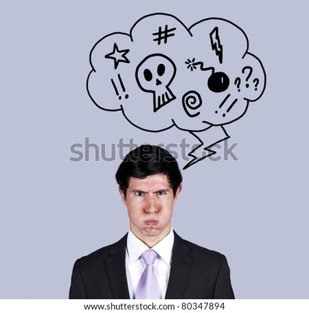 Furious businessman with a speech balloon with bad thoughts (isolated on gray) - stock photo