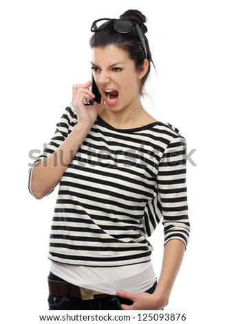 Furious girl with cell phone on a white background.