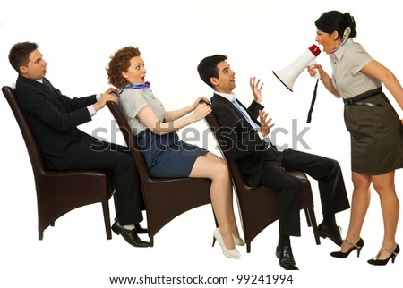 Furious manager shouting through megaphone to amazed employees on chairs against white background