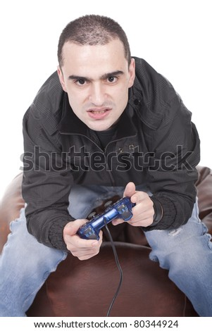 Furious young man with a joystick for game console - stock photo