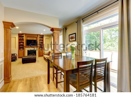 Furnished luxury living room with leather ottoman. View of fireplace with tv and built-in cabinet #185764181