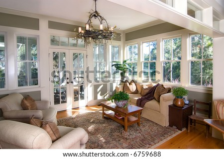 Furnished Sunroom With Large Windows And Glass Doors Stock