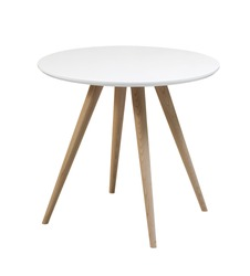 Furniture from 50-60 years of the last century.White round table with wooden legs on a white background