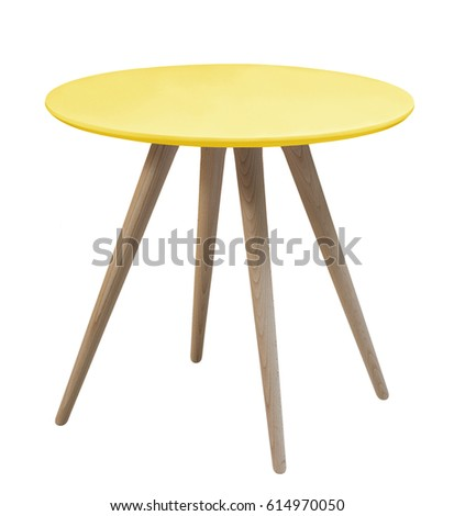 Furniture from 50-60 years of the last century.Yellow round table with wooden legs on a white background #614970050