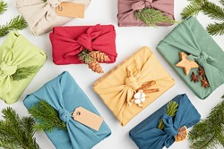 Furoshiki gifts. Eco friendly alternative green Xmas presents wrapped in clothes. Japanise tradition. Zero waste Christmas, flat lay, top view
