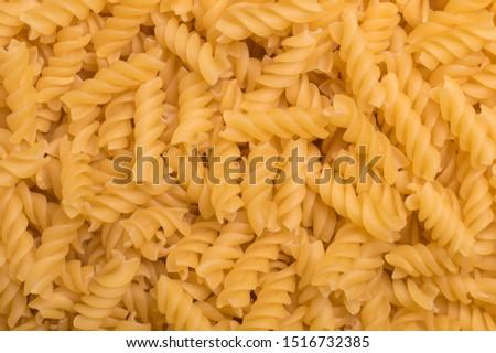 Fusilli spaghetti pattern background. Fusilli background. #1516732385