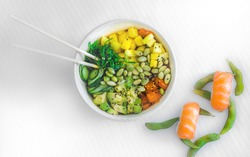 Fusion, asian and mediterranean salad in a white bowl with light background and soft light. Mediterranean and healthy diet.