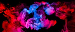 fusion of blue and red smoke in motion isolated on black background