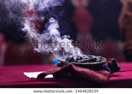 Fusion of cultural & modern music event. A close up view of embers smoking in a sacred dish during a festival of Native American cultures and traditions mystical object used by shaman, with copy space #1464828539