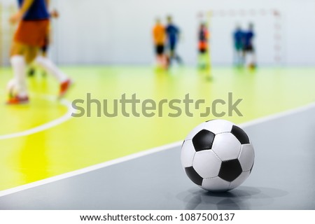 Futsal Background. Indoor Soccer Futsal Ball. Indoor Soccer Match in the Background. Futsal Sports Hall and Futsal Field. Youth Indoor Soccer League.