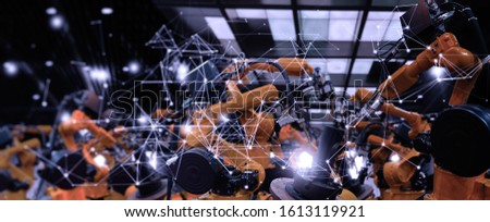 Future factory concept with automation robot arms machine in intelligent factory industrial on real time monitoring system software.Digital future manufacture.