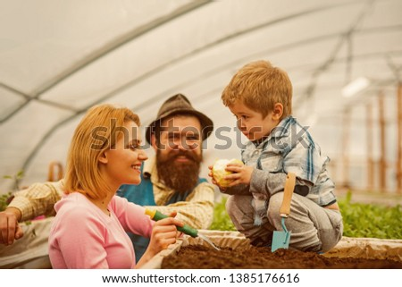 future farmer. family care about future farmer. future farmer child with parents. future farmer concept. paople with flowers #1385176616