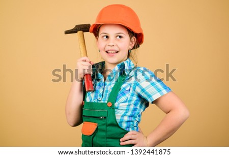 Future profession. Child care development. Builder engineer architect. Kid worker in hard hat. Tools to improve yourself. Repair. small girl repairing with hammer in workshop. Building is her life. #1392441875