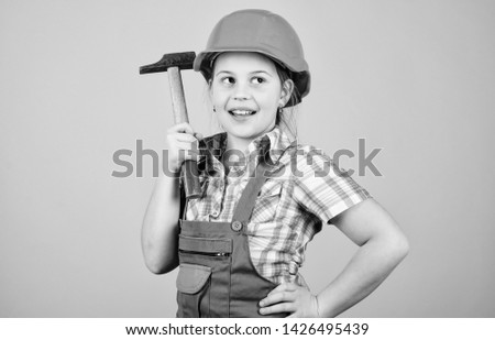 Future profession. Child care development. Builder engineer architect. Kid worker in hard hat. Tools to improve yourself. Repair. small girl repairing with hammer in workshop. Building is her life. #1426495439