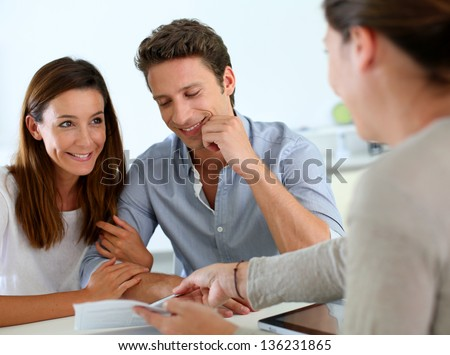 Future property owners reading terms of contract