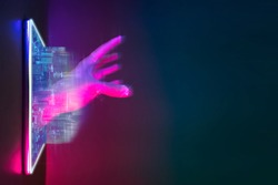 Future technology cyberpunk neon color concept. Mobile phone with city and artificial intelligence hand hologram for digital technology. Background copy space on right side.