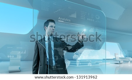 Future technology touchscreen interface. Man touching screen interface in hi-tech interior. Businessman  drawing chart in futuristic office.