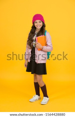 Future textbooks modern education. Textbook useful in learning environment. School creating textbooks generation. Active role in curriculum. Schoolgirl with textbooks. Innovating existing platforms.