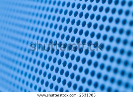 Futuristic blue hole grid making an abstract pattern. Shallow DOF.