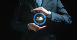 Futuristic businessman, assistant, worker in suit holds a blue ball with the inscription 24 hours on a black background. Concept 24 hours work, fast delivery, help always, communication, sale purchase