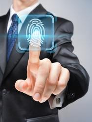 Futuristic businessman pushing cybersecurity button