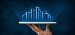 Futuristic City. Male Hand Holding Digital Tablet With Modern Cityscape And Holographic Highrise Buildings On Blue Background. Panorama, Collage