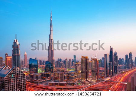 Futuristic Dubai city center skyline at  sunset, Dubai, United Arab Emirates