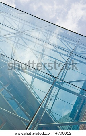 futuristic glass building reflecting the sky
