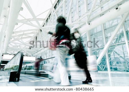 Futuristic guangzhou Airport interior people walking in motion blur